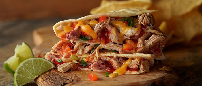 SADLER'S SMOKEHOUSE® pulled pork in a quesadilla with melted cheese.