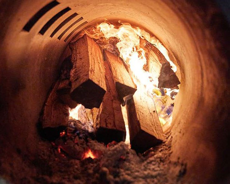 Image of wood burning in a smoker.
